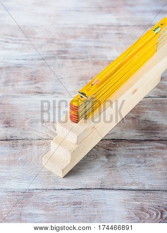 Wooden material pieces and measuring meter yellow pencil tools for bricolage diy hand made craft