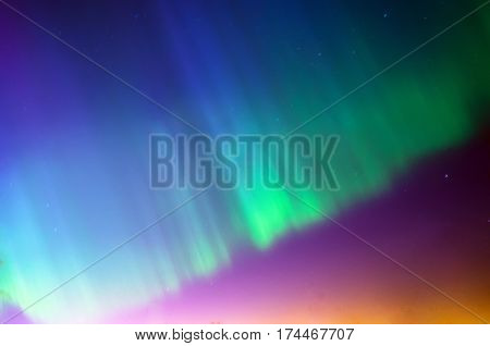 Colorful northern lightsPolar northen Lights aurora borealis. Sky night stars.