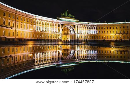 Palace Square puddles and the Nevsky Prospekt night lights old houses St. Petersburg.