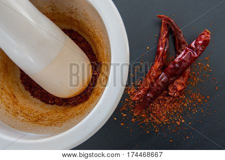 Mortar And Pestle With Ground And Whole Thai Chili