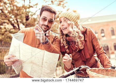 Couple of tourist.Happy couple of tourist on a bike ride.