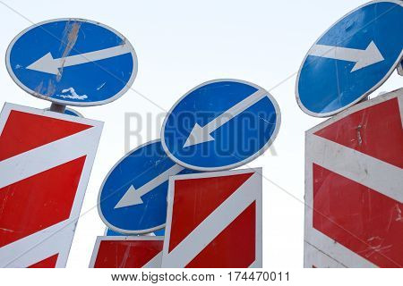 confusion mess of direction arrows traffic signs