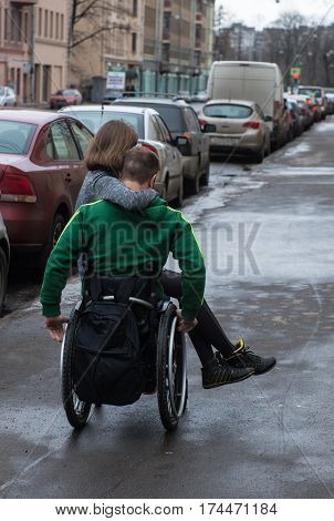 A Disabled Young Man  In A Wheelchair With  Girl