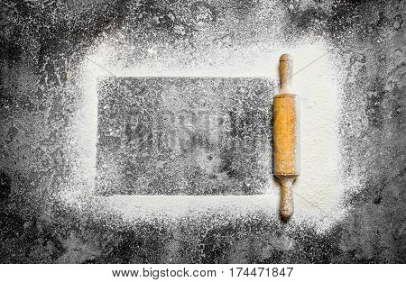 Baking Background. Frame Of Sifted Flour With A Rolling Pin. On Rustic Background.