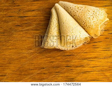Thin Pancakes On A Wooden Background Top View