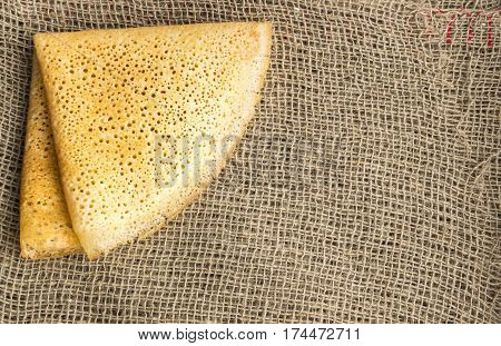 Thin Pancakes On A Burlap Background Top View
