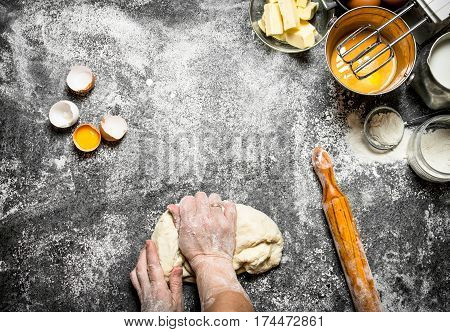 Dough Background. Woman Kneads Dough With Various Ingredients On The Table.