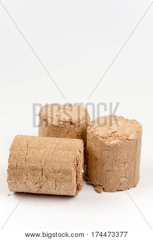 Three Wooden Briquettes Made Of Pressed Sawdust