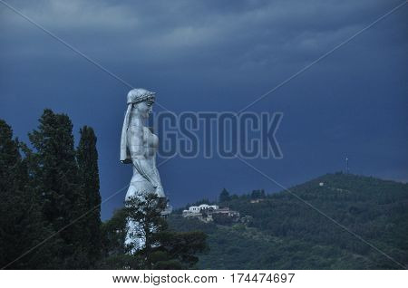 Tbilisi. View of the city and a monument to the mother of Georgia from the hill during the storm.