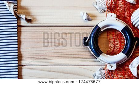small decorative lifebuoy on the background of of wooden boards