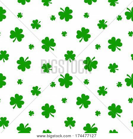 Vector St. Patrick's day seamless pattern with green shamrock leaves on a white background.