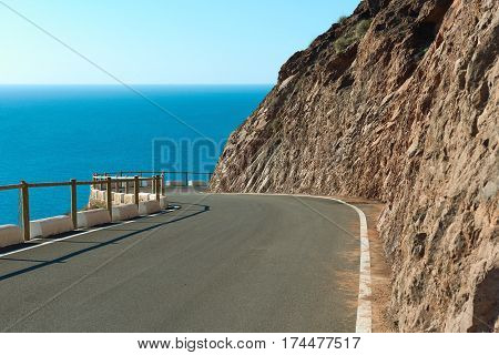 Empty mountain winding road leading to the Cabo de Gata-Nijar Natural Park. South-eastern corner of Spain