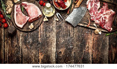 Raw Meat Background. Raw Pork Chop With A Variety Of Herbs And Spices.