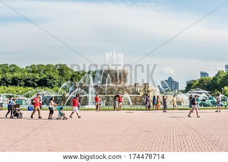 Chicago USA - May 30 2016: Buckingham Memorial Fountains in Grant Park in Illinois with skyscrapers and people walking on a hot summer day with skycrapers