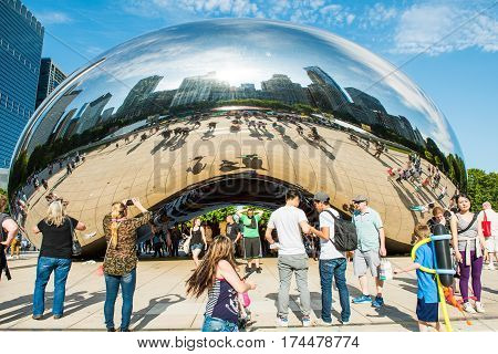 Chicago USA - May 30 2016: Chicago bean in Millennium Park with many people and buildings in background