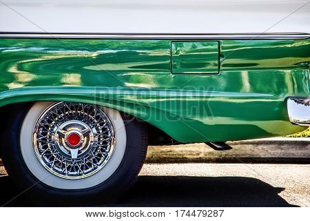 The rear end of a classic American car in southern California.