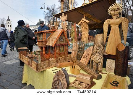 VILNIUS LITHUANIA - MARCH 4: Traditional Lithuanian wood sculptures in annual traditional crafts fair - Kaziuko fair on March 4 2017 in Vilnius Lithuania