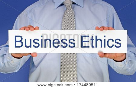Business Ethics - manager holding sign with text