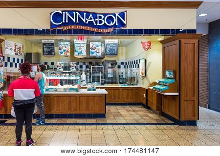 Burke USA - February 18 2017: Cinnabon cinnamon roll fast food joint exterior