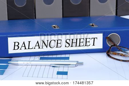 Balance Sheet - blue binder on desk in the office