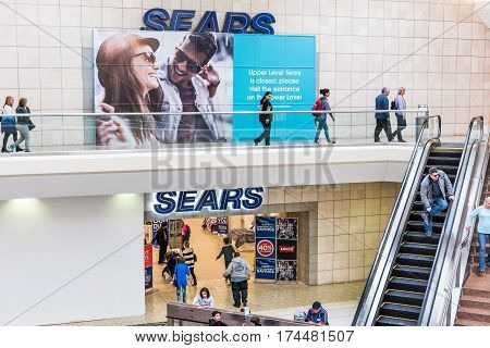Fairfax USA - February 18 2017: Sears sign exterior in mall with escalator and closure sign
