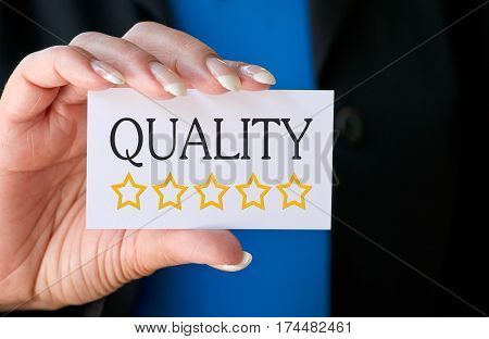 Excellent Quality with Five Stars - female hand with business card