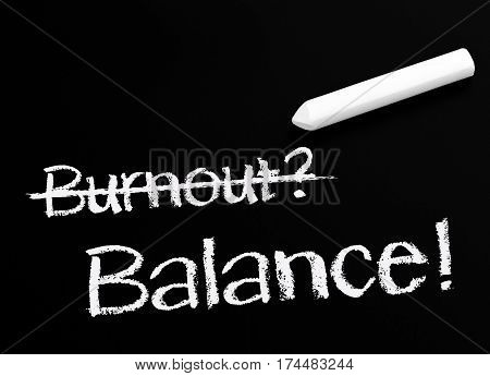 Burnout and Balance - concept chalkboard with chalk and text