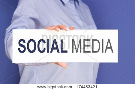Social Media - Businesswoman holding sign with text