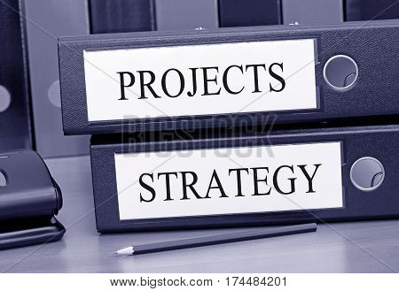 Projects and Strategy - two binders in the office