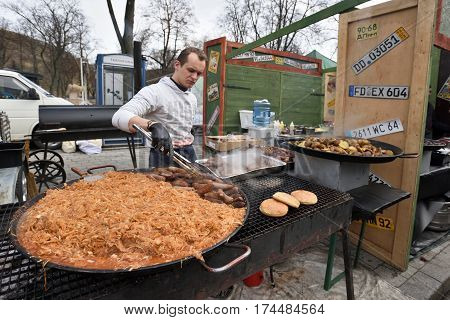 VILNIUS LITHUANIA - MARCH 4: Unidentified people trade food in annual traditional crafts fair - Kaziuko fair on March 4 2017 in Vilnius Lithuania