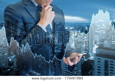 Double Exposure Of Professional Businessman Hold And Analyze Smart Phone With Cityscape And Financia