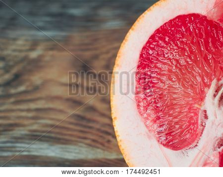 Macro Shot Of A Half Grapefruit On A Wooden Table, Close Up