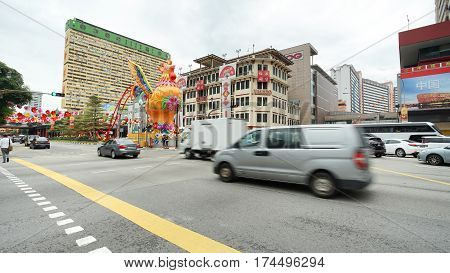 SINGAPORE - JANUARY 20: Chinatown street traffic in Chinatown district Singapore. Chinese New Year celebrations in 2017.