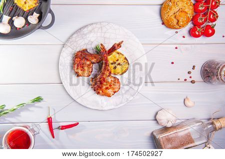 Close Up Gourmet Grilled Veal Loin Steak Meat With Grilled Lemon On A White Plate, Served On Top Of