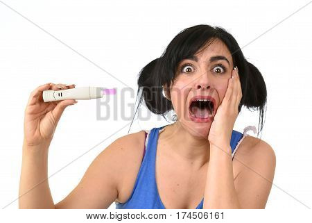 young pregnant woman scared in shock checking pink positive result on pregnancy test surprised and stressed in accidental motherhood and unwanted baby isolated on white background poster