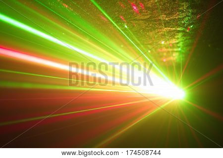 Green and red laser in a nightclub. Laser beams on a dark background club atmosphere