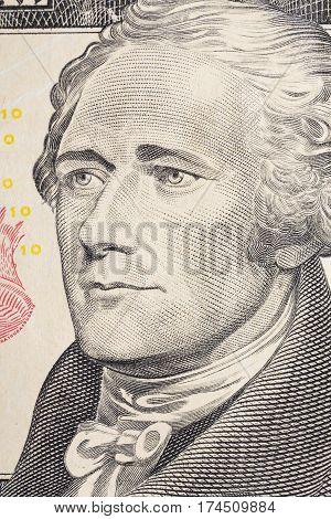 Vertical portrait of Alexander Hamilton's face on the US 10 dollar bill. Macro shot.