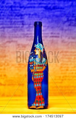 a decorative bottle with a picture of an Egyptian woman. Contemporary art, hand-painted colors