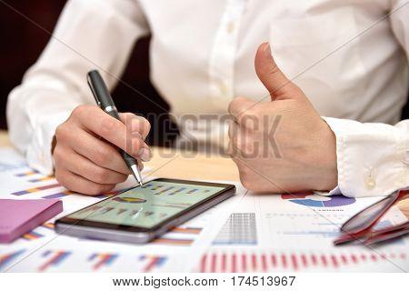 Trader Woman Showing Thumb Up