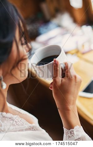 Coffee. Beautiful Girl Drinking Coffee Beauty Model Woman with the Cup of Hot Beverage.