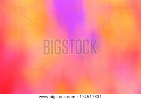 Multicolored spotted background. Red, yellow and purple spots. Blur.