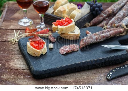 Making Pintxo With Tomato And Sausages, Tapas, Spanish Canapes Party Finger Food