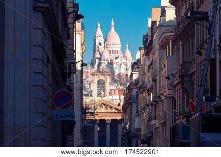 Sacre-Coeur Basilica or Basilica of the Sacred Heart of Jesus and Notre-Dame de Lorette church, seen from Rue Laffitte in the winter morning, Paris, France