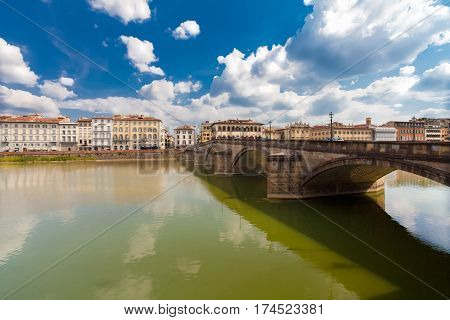 Florence ITALY- September 11 2016: View on the five-arched bridge (Ponte alla Carraia) over Arno river in Florence