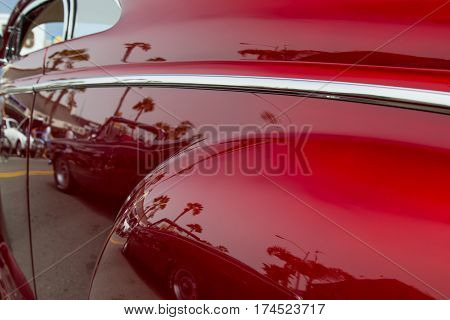The driver's side of a 1940 's era classic car.