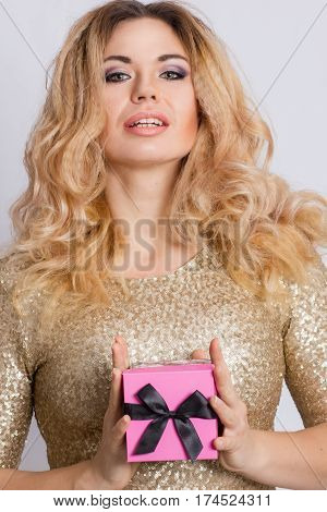 Woman happy smile hold gift box in hands, isolated over gray background