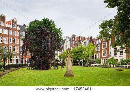 Beautiful World famous Begijnhof Beguinage is one of the oldest inner courts in the city of Amsterdam with group of historic buildings. Begijnhof was founded during the Middle Ages. Netherlands.