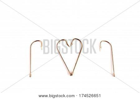 Fishing Hooks Isolated On A White Background. Several Metallic Stainless Hooks Lie Randomly On The B