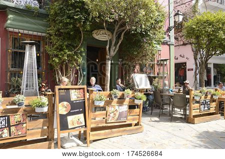 MARBELLA, SPAIN - FEBRUARY 27, 2017: People sitting at the terrace of a restaurant in the historic center of Marbella a city of the province of Malaga Andalusia Spain.