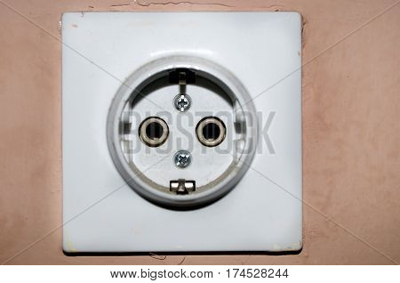 Three white European 220V power socket on green wall in Novi Sad, Serbia